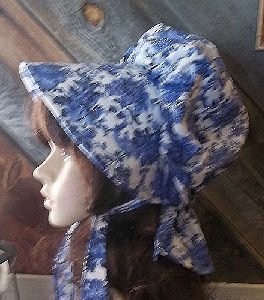 Delft blue colored oriental flowered pattern sun bonnet