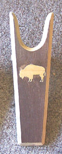 Sturdy Pine Boot Jack with a light Buffalo Sillhouette on dark background from Rawhide Gifts and Gallery
