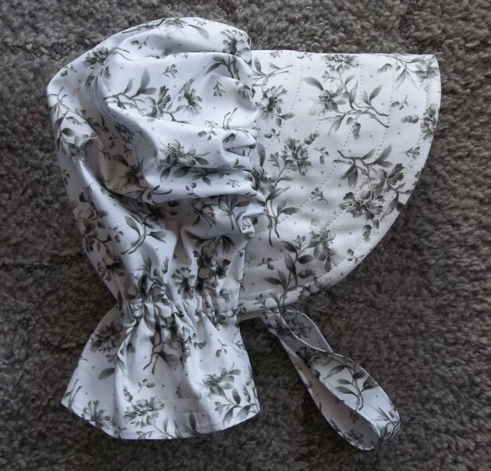 Beautiful bonnet of light silver background with charcoal colored flowers clusters-Rawhide Gifts and Gallery