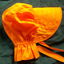 Bright and flashy orange bonnet looks great on brunettes