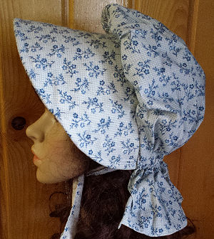 Period Correct Bonnet, light blue background with darker blue roses