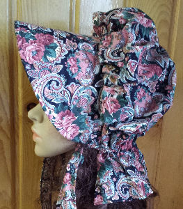 Period Correct Bonnet-large cluseter of muted flowers and roses on blk bkgrd