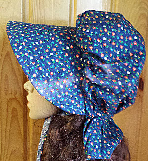 Period Correct Bonnet-medium navy blue, small flowers similar to a calico