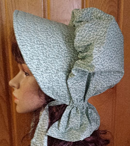 Period Correct Bonnet mint green; subtle pattern