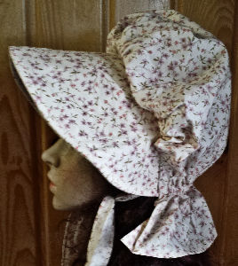 Period Correct cream colored bonnet with tiny pastel flowers