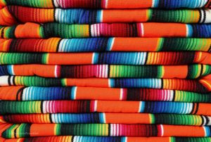 Bright Orange and Assorted Pastel colored Mexiocan Serape throw or blanket