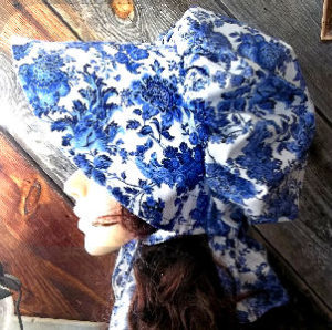 Delft Blue Colored Ladies sunbonnet with bright blue flowers