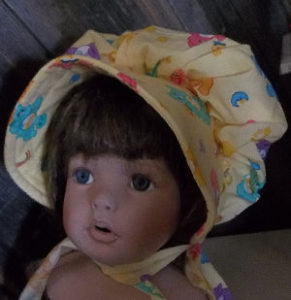 baby bonnet with care bears pattern