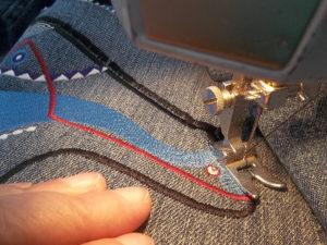 ziz zag stitch your zuni bear applique to a jacket